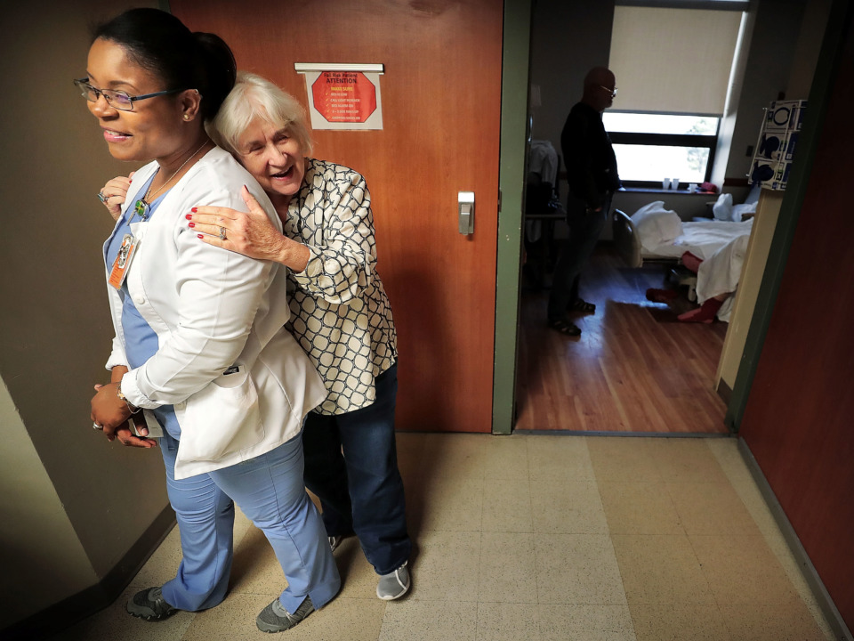 <strong>Janet Coomer, whose husband was recently admitted to St. Francis for congestive heart failure, embraces nurse Jodine James (left), a native  of Jamaica, while she makes her rounds in the cardiology wing at Saint Francis Hospital on Jan. 10, 2019. St. Francis is trying to address a perennial nursing shortage by recuiting outside the United States.</strong> (Jim Weber/Daily Memphian)