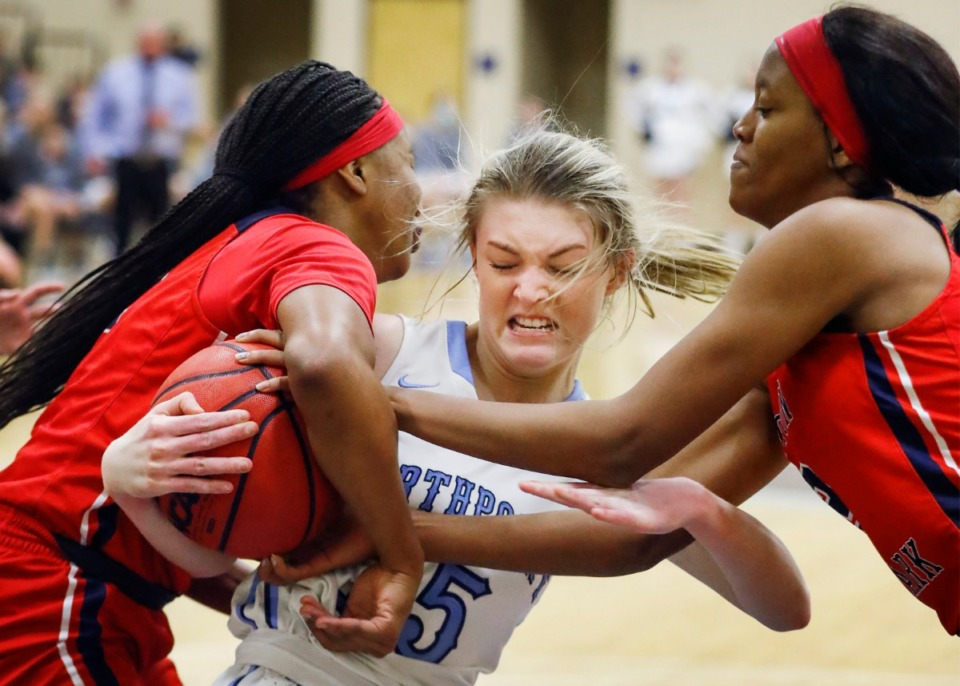 <strong>Northpoint Christian forward Brylee Faith Cherry battles Tipton-Rosemark Academy&rsquo;s Raven Sims (left) and Brianna Hall (right) for a loose ball during the Division 2-A West Region postseason game on Monday, Feb. 22, 2021.</strong> (Mark Weber/The Daily Memphian)