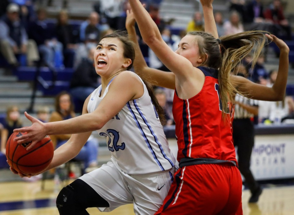 <strong>Northpoint Christian guard Isabella Carlson (left) drives for a layup against Tipton-Rosemark Academy on Monday, Feb. 22, 2021.</strong> (Mark Weber/The Daily Memphian)