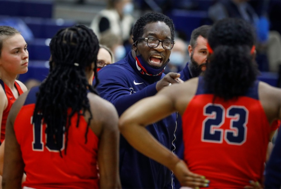 <strong>Unhappy Tipton-Rosemark Academy head coach Cedric Anderson (middle) talks to his players during a break in the game against Northpoint Christian on Monday, Feb. 22, 2021.</strong> (Mark Weber/The Daily Memphian)