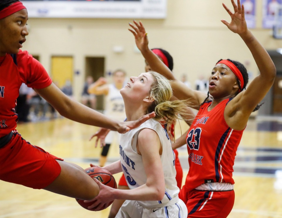 <strong>Northpoint Christian forward Brylee Faith Cherry (middle) drives to the basket against Tipton-Rosemark Academy&rsquo;s Raven Sims (left) and Elyse Warren (right) on Monday, Feb. 22, 2021.</strong> (Mark Weber/The Daily Memphian)