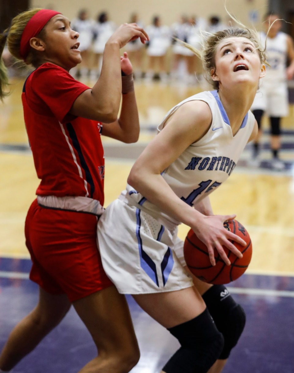 <strong>Northpoint Christian forward Brylee Faith Cherry drives the lane against Tipton-Rosemark Academy&rsquo;s Savannah Scruggs (left) on Monday, Feb. 22, 2021.</strong> (Mark Weber/The Daily Memphian)