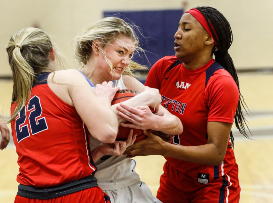 <strong>Northpoint Christian forward Brylee Faith Cherry (middle) battles Tipton-Rosemark Academy&rsquo;s forward Jordan Allen (left) and Even Sims (right) for a rebound on Monday, Feb. 22, 2021.</strong> (Mark Weber/The Daily Memphian)