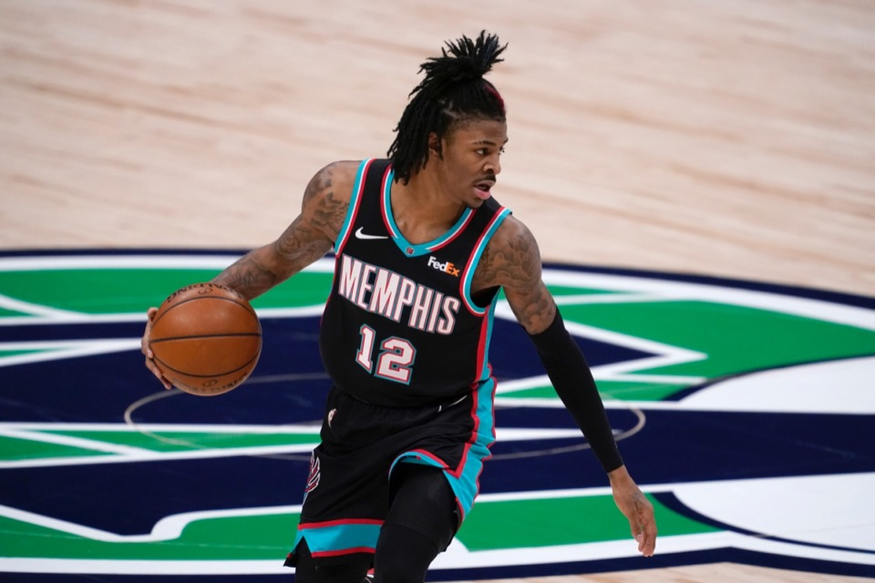 <strong>Grizzlies guard Ja Morant (12) handles the ball in the game against the Dallas Mavericks in Dallas, Monday, Feb. 22, 2021.</strong> (Tony Gutierrez/AP)