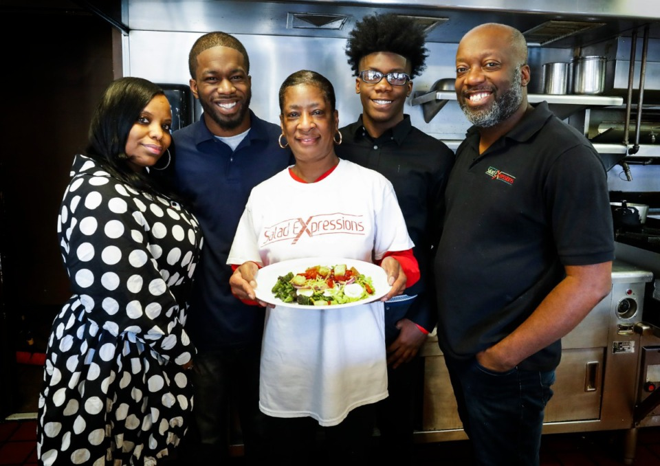 <strong>The Wilson family&nbsp;&mdash; (left to right) Yolanda, Levell, LaJuanese, Latrell and Lemichael&nbsp;&mdash; stand in the kitchen of their new Salad Expressions restaurant on Tuesday, Feb. 23, 2021, in the recently closed E's 24 Hour Cafe on Union Avenue. Salad Expressions will eventually be surrounded by URBN, a $55 million mixed-use development.</strong> (Mark Weber/The Daily Memphian)