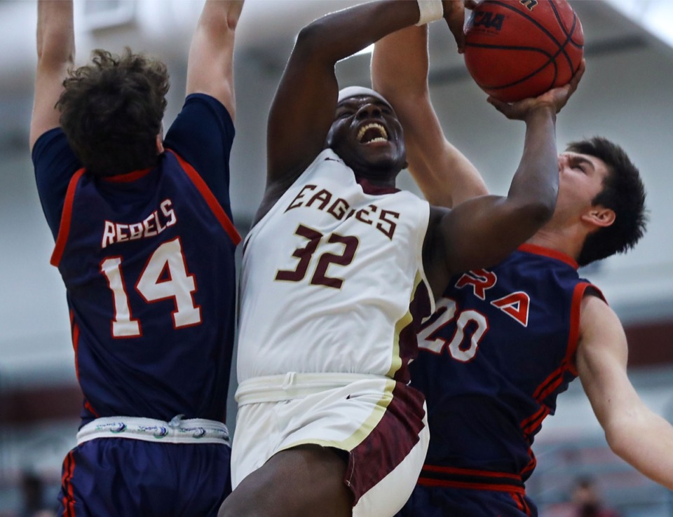 <strong>ECS guard Dominic Brown (32) goes up for a contested layup during the Feb. 23, 2021, game against Tipton-Rosemark.</strong> (Patrick Lantrip/Daily Memphian)