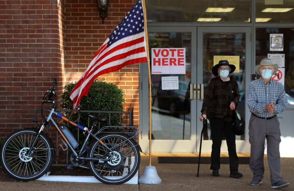 <strong>Stephanie and Frank Chalona leave the early voting location at Mississippi Boulevard Christian Church after waiting in line for nearly an hour and a half on Oct. 14, 2020.</strong> (Patrick Lantrip/Daily Memphian file)