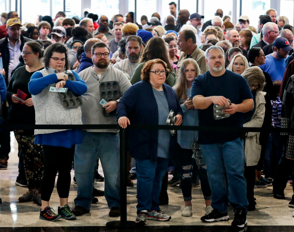 <strong>Hundreds of people holding cupcake pans wait for the 31st Annual Youth Villages' Soup Sunday fundraiser to open on Sunday, Feb. 23, 2020, at the FedExForum.</strong> (Mark Weber/Daily Memphian)