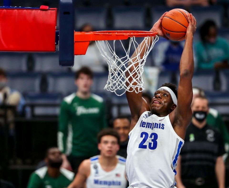 <strong>University of Memphis center Malcolm Dandridge (23) dunks the ball against Tulane on Feb. 24, 2021.</strong> (Patrick Lantrip/Daily Memphian)