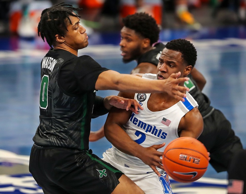 <strong>University of Memphis guard Alex Lomax (2) fights through a Tulane double team during on Feb. 24, 2021.</strong> (Patrick Lantrip/Daily Memphian)