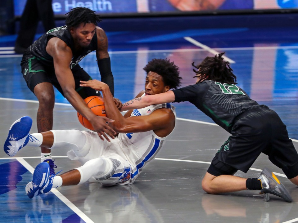 <strong>University of Memphis forward Deandre Williams (12) fights for a loose ball on Feb. 24, 2021, during the game against Tulane.</strong> (Patrick Lantrip/Daily Memphian)