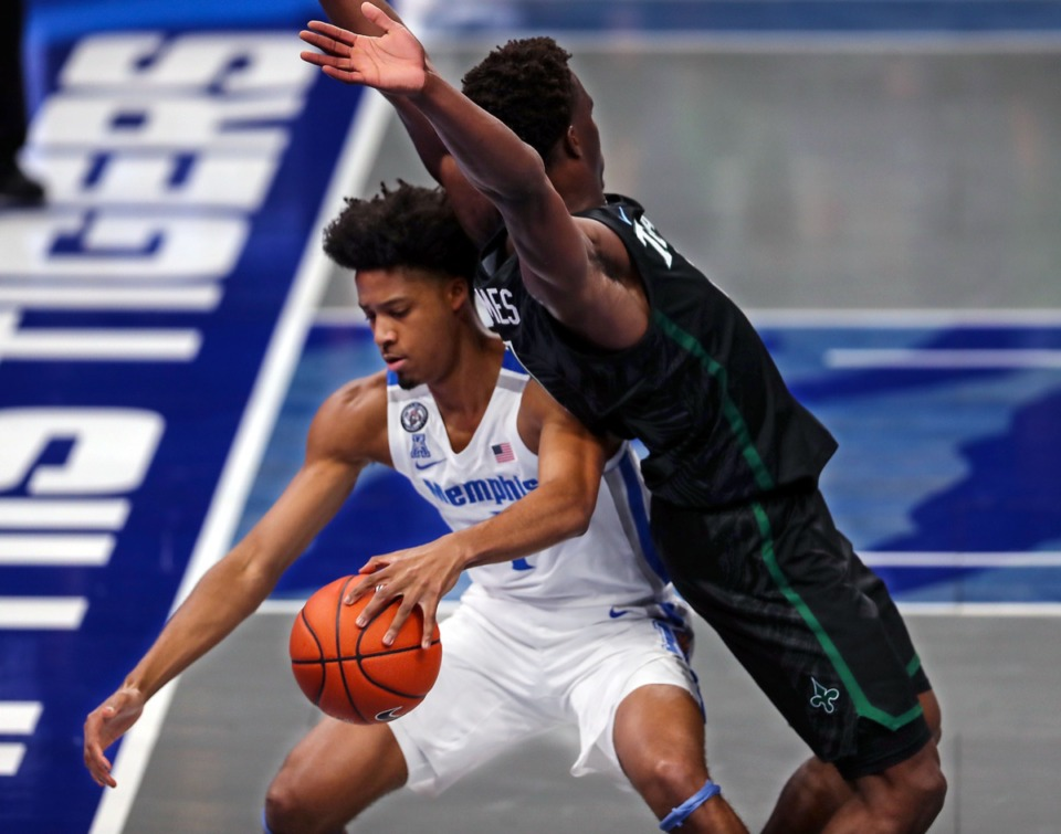 <strong>University of Memphis guard Jayden Hardaway (1) dribbles around a defender during the Feb. 24 game against Tulane.</strong> (Patrick Lantrip/Daily Memphian)