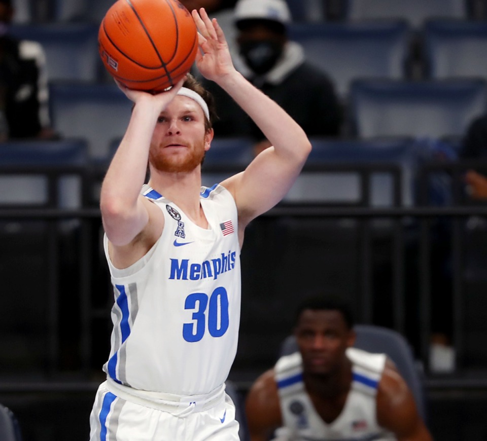 <strong>University of Memphis guard Conor Glennon (30) shoots a three during the Feb. 24 game against Tulane.</strong> (Patrick Lantrip/Daily Memphian)