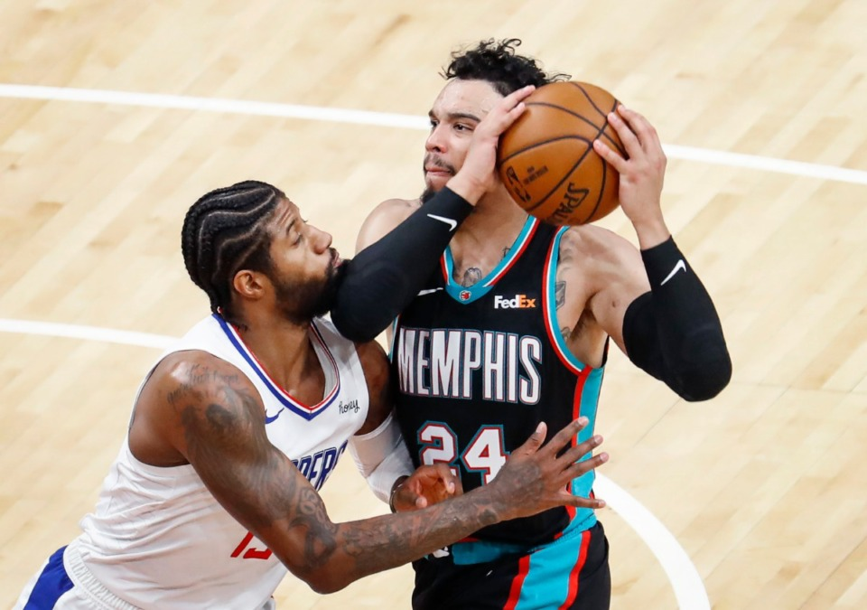 <strong>Grizzlies guard Dillion Brooks (right) drives the lane against Los Angeles&rsquo; Paul George (left) on Thursday, Feb. 25, 2021.</strong> (Mark Weber/The Daily Memphian)