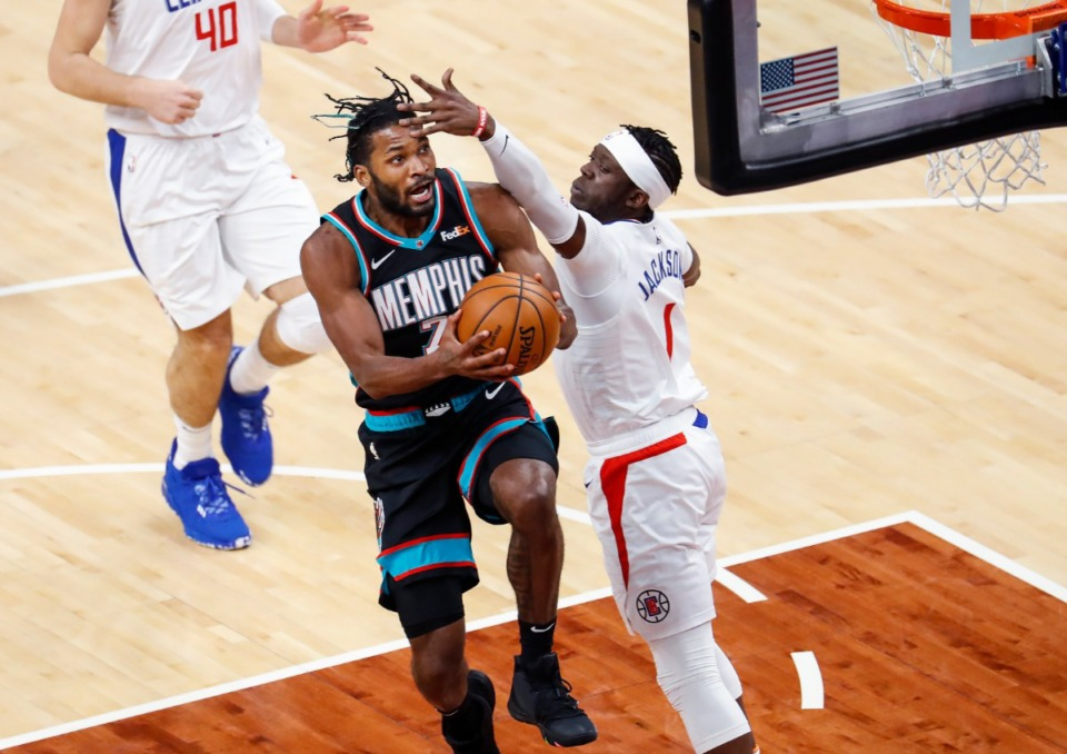 <strong>Grizzlies guard Justise Winslow (left) drives for a layup against Los Angeles&rsquo; Reggie Jackson (right) on Thursday, Feb. 25, 2021.</strong> (Mark Weber/The Daily Memphian)