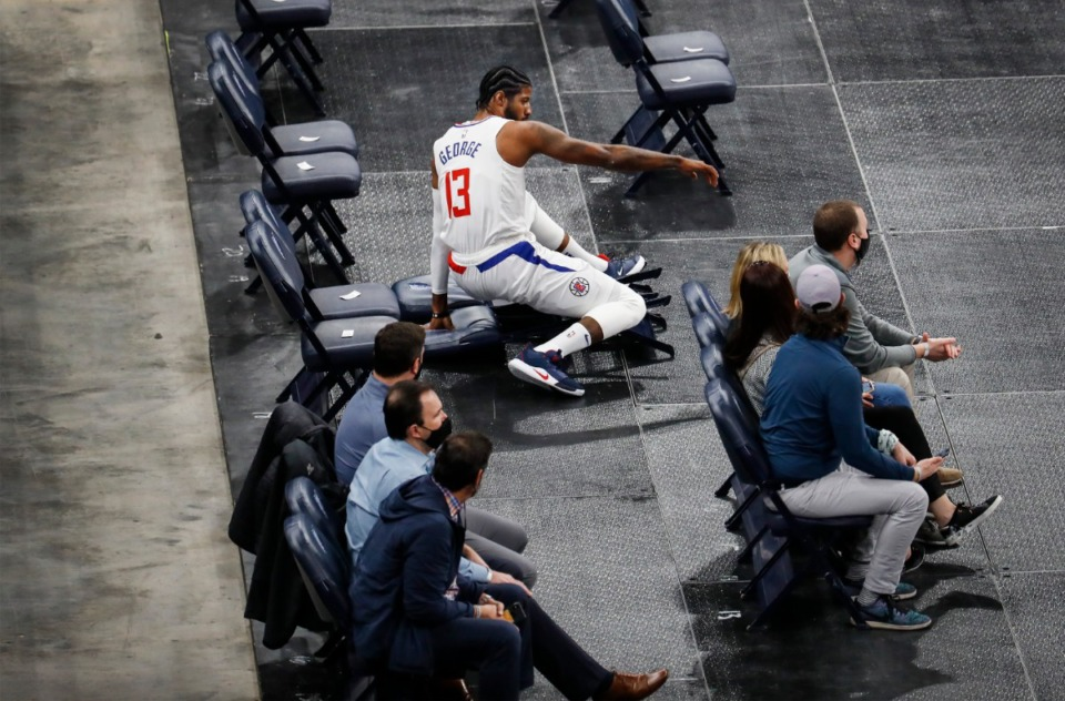 <strong>Los Angeles&rsquo; Paul George falls into fan seats after chasing a loose ball during the game against the Memphis Grizzlies on Thursday, Feb. 25, 2021.</strong> (Mark Weber/The Daily Memphian)