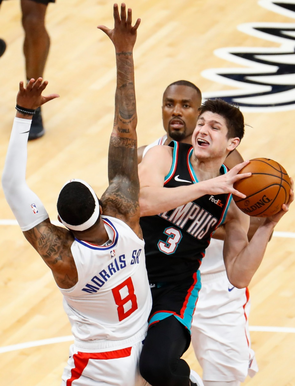 <strong>Grizzlies guard Grayson Allen (middle) drives to the basket against Los Angeles Clippers Marcus Morris Sr. (front) and Serge Ibaka (back) on Thursday, Feb. 25, 2021.</strong> (Mark Weber/The Daily Memphian)
