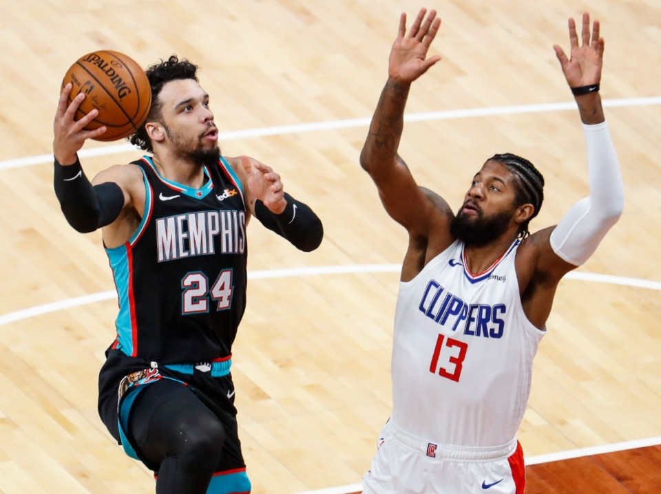 <strong>Grizzlies guard Dillion Brooks (left) drives the lane against Clipper Paul George (right) on Thursday, Feb. 25, 2021.</strong> (Mark Weber/The Daily Memphian)