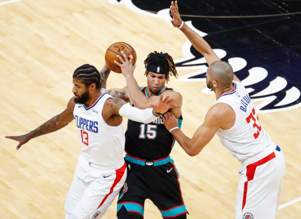 <strong>Grizzlies forward Brandon Clarke (middle) tries to pass while guarded by Clippers Paul George (left) and Nicolas Batum (right) on Feb. 25, 2021.</strong> (Mark Weber/The Daily Memphian)
