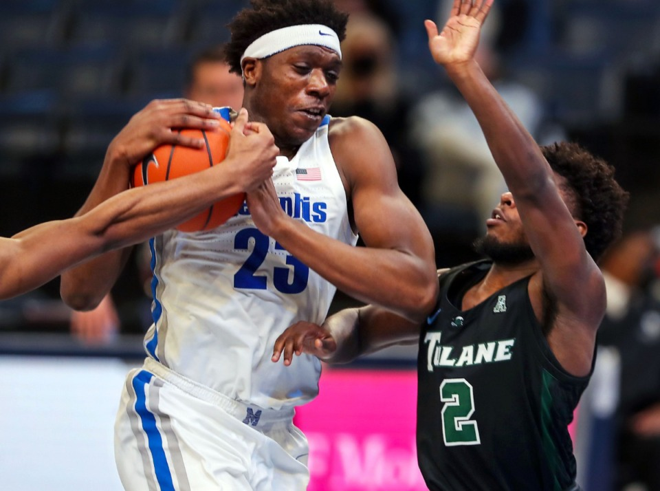 <strong>University of Memphis center Malcolm Dandridge (23) drives through the lane during a Feb. 24, 2021 game against Tulane.</strong> (Patrick Lantrip/Daily Memphian)