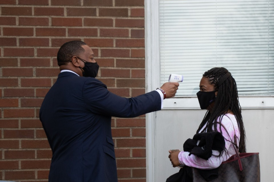 <strong>Shelby County Schools Superintendent Dr. Joris Ray checks temperatures of arriving teachers and employees getting vaccinated Wednesday, Feb. 24.</strong> (Daja E. Henry/Daily Memphian)