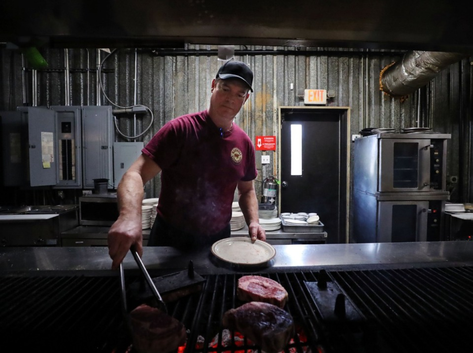 <strong>Chuck Burnette cooks steaks at Marshall Steakhouse Feb. 25, 2021.</strong> (Patrick Lantrip/Daily Memphian)