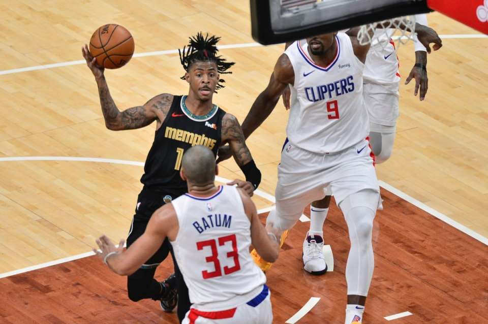 <strong>Memphis Grizzlies guard Ja Morant drives against Los Angeles Clippers forward Nicolas Batum (33) and center Serge Ibaka (9) on Friday, Feb. 26.</strong> (Brandon Dill/AP)
