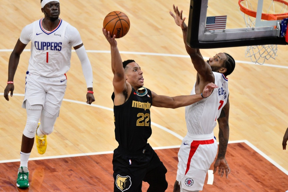 <strong>Grizzlies guard Desmond Bane (22) shoots against Los Angeles Clippers forward Kawhi Leonard (2) on Feb. 26.</strong> Tenn. (AP Photo/Brandon Dill)