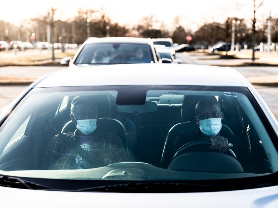 <strong>Tyrone Currie (right) drives his parents, James Thomas Currie (left) and Luvenia Currie, while waiting outside the Pipkin Building to receive their COVID-19 vaccines, Friday, Jan. 29, 2021.</strong> (Brad Vest/Daily Memphian file)