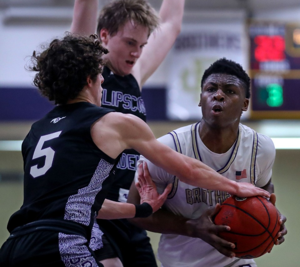 <strong>CBHS guard Chandler Jackson (1) drives to the lane during a Feb. 27, 2021 game against Lipscomb Academy in Memphis.</strong> (Patrick Lantrip/Daily Memphian)