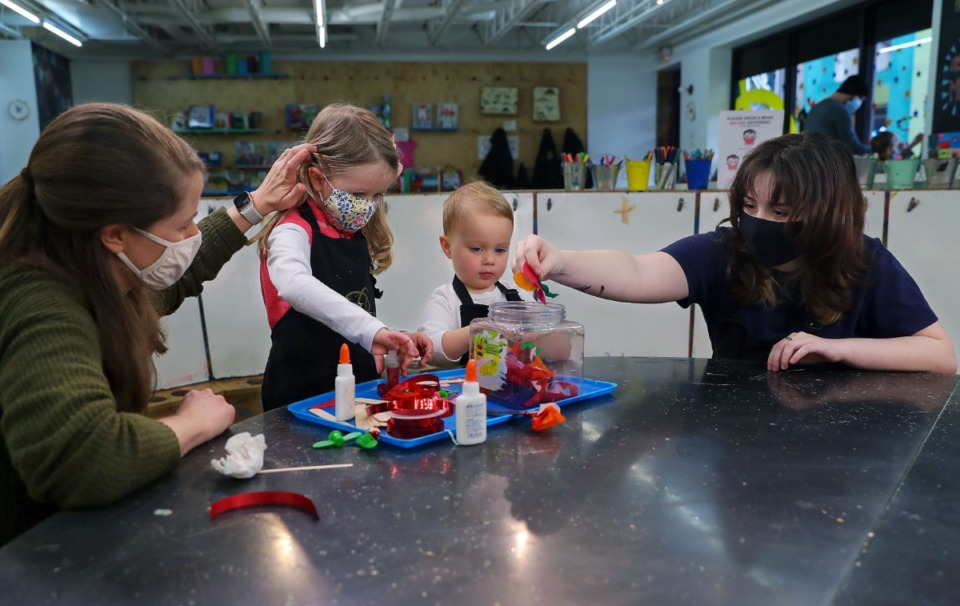 <strong>Paige Fernandez (right) helps Mary-Wilkes Yonchak (left) and her two children Harris and Elizabeth at The Art Project Feb. 26, 2021. Paige, who is a student at Grace-St. Luke&rsquo;s Episopal School, completed a three-day internship at the Overton Square business.</strong> (Patrick Lantrip/Daily Memphian)