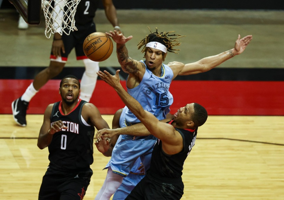 <strong>Memphis Grizzlies forward Brandon Clarke (15) defends against a shot by Houston Rockets guard Eric Gordon (10) during the first quarter of an NBA basketball game Sunday, Feb. 28, 2021, in Houston.</strong> (Troy Taormina/AP)