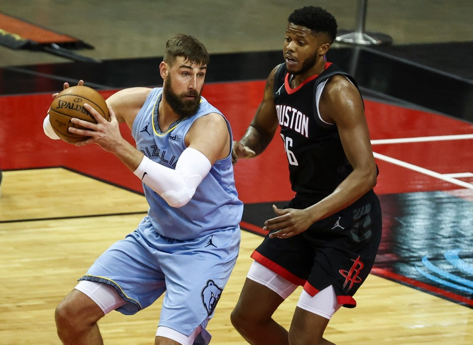 <strong>Memphis Grizzlies center Jonas Valanciunas (17) controls the ball as Houston Rockets center Justin Patton (26) defends during the first quarter of an NBA basketball game in Houston, Sunday, Feb. 28, 2021.</strong> (Troy Taormina/AP)
