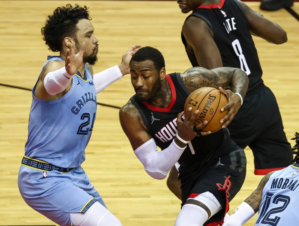 <strong>Houston Rockets guard John Wall (1) drives with the ball as Memphis Grizzlies guard Dillon Brooks (24) defends during the second quarter of an NBA basketball game Sunday, Feb. 28, 2021, in Houston.</strong> (Troy Taormina/AP)