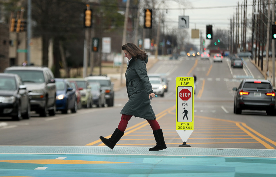 <strong>Claire Ashbrook crosses Manassas between Health Sciences Park and the UTHSC Cancer Research Building Friday, Jan. 11, 2019. More fixtures like this crosswalk will be added to the area in the coming months.</strong> (Patrick Lantrip/Daily Memphian)
