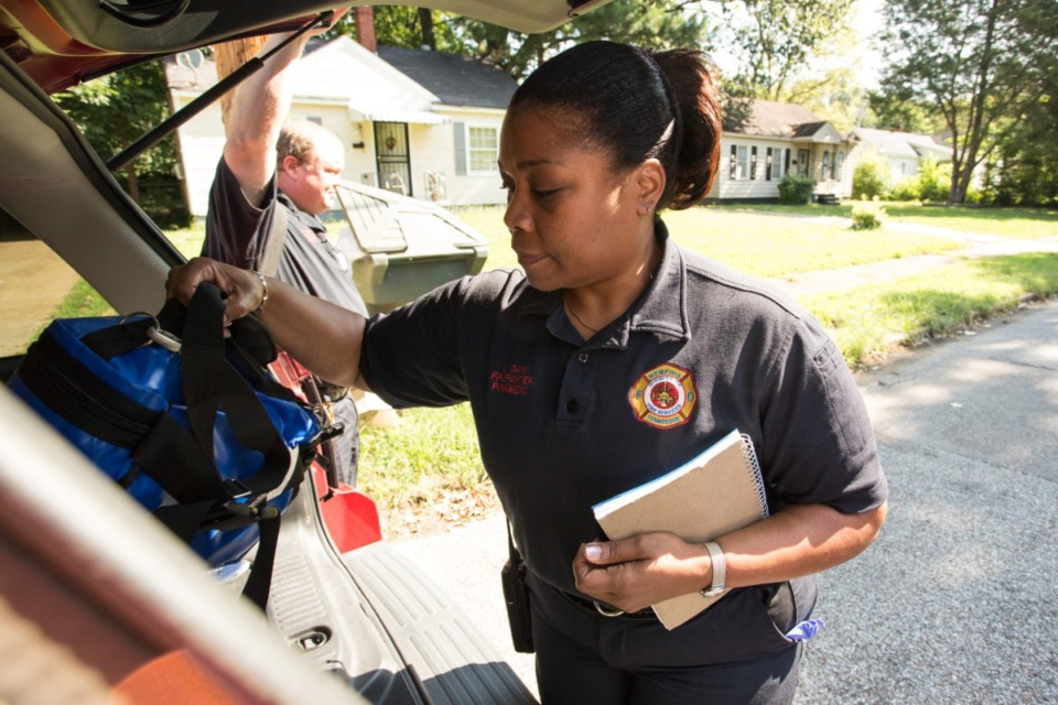 <strong>Memphis Fire Department paramedics Tim Davis and Demetria Davis retrieve their medical kits during a routine visit to a patient's home. The Shelby County Fire Department is training its dispatchers on how to handle mental health calls.</strong> (Daily Memphian file)