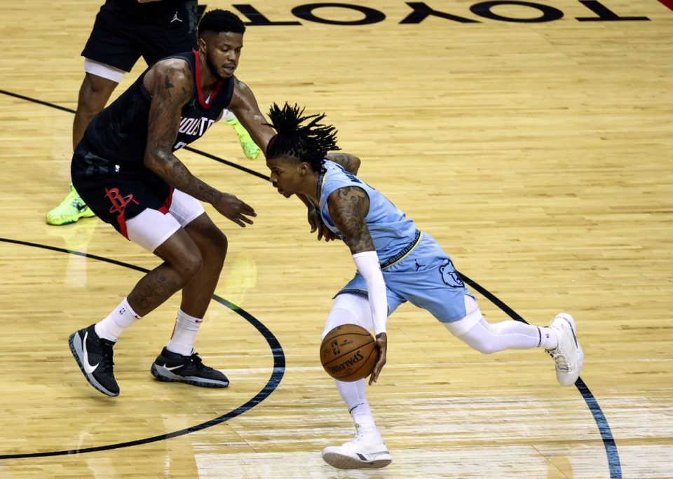 <strong>Memphis Grizzlies guard Ja Morant, right, dribbles against the Houston Rockets during the third quarter of an NBA basketball game Sunday, Feb. 28, 2021, in Houston.</strong> (Troy Taormina/AP)