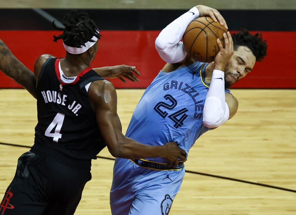 <strong>Memphis Grizzlies guard Dillon Brooks (24) attempts to keep control of the ball as Houston Rockets forward Danuel House Jr. (4) defends during the third quarter of an NBA basketball game Sunday, Feb. 28, 2021, in Houston.</strong> (Troy Taormina/AP)