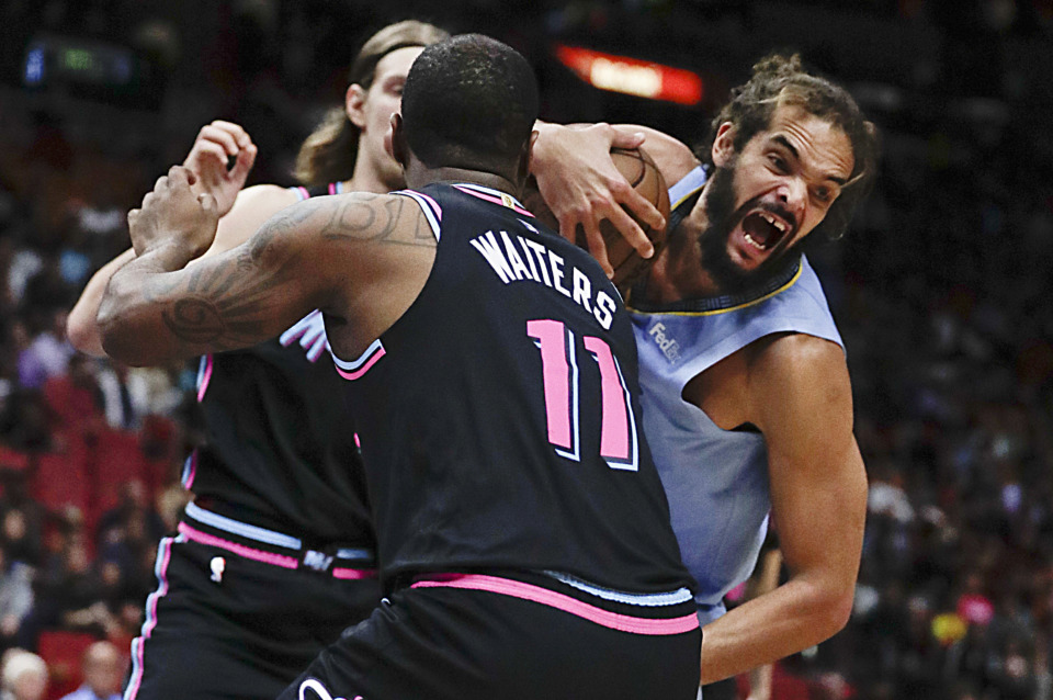 <strong>Memphis Grizzlies center Joakim Noah reacts after rebounding the ball against Miami Heat guard Dion Waiters (11) in the first half of an NBA game Saturday, Jan. 12, 2019, in Miami.</strong> (AP Photo/Brynn Anderson)