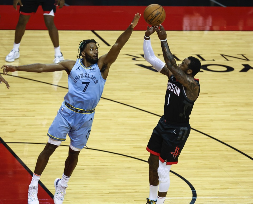 <strong>Grizzlies forward Justise Winslow (7) blocks the shot of Houston Rockets guard John Wall (1) on Feb. 28.</strong>&nbsp;<strong>While Winslow&rsquo;s offensive output is usually solid, it&rsquo;s his defensive skills that are proving crucial.</strong> (Troy Taormina/AP file)