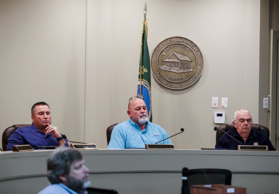 <strong>Mayor Mike Wissman (left) along with Aldermen Oscar Brooks (middle) and Vice Mayor Harry McKee (right) attend an Arlington Board of Mayor and Aldermen meeting during March of last year.</strong> (Mark Weber/Daily Memphian file)