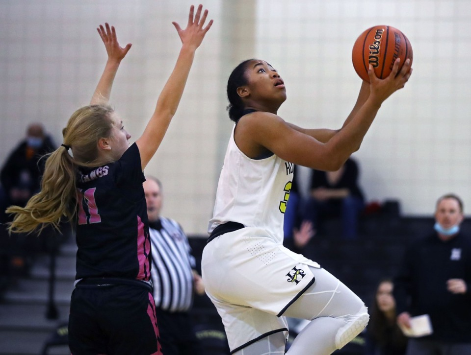 <strong>Hutchison forward Carmyn Harrison (33) goes up for a layup on Jan. 6, 2020.</strong>&nbsp;<strong>The Division 2-AA Miss Basketball finalist scored 18 points and handed out five assists on Feb. 27 against Brentwood Academy.</strong> (Patrick Lantrip/Daily Memphian file)