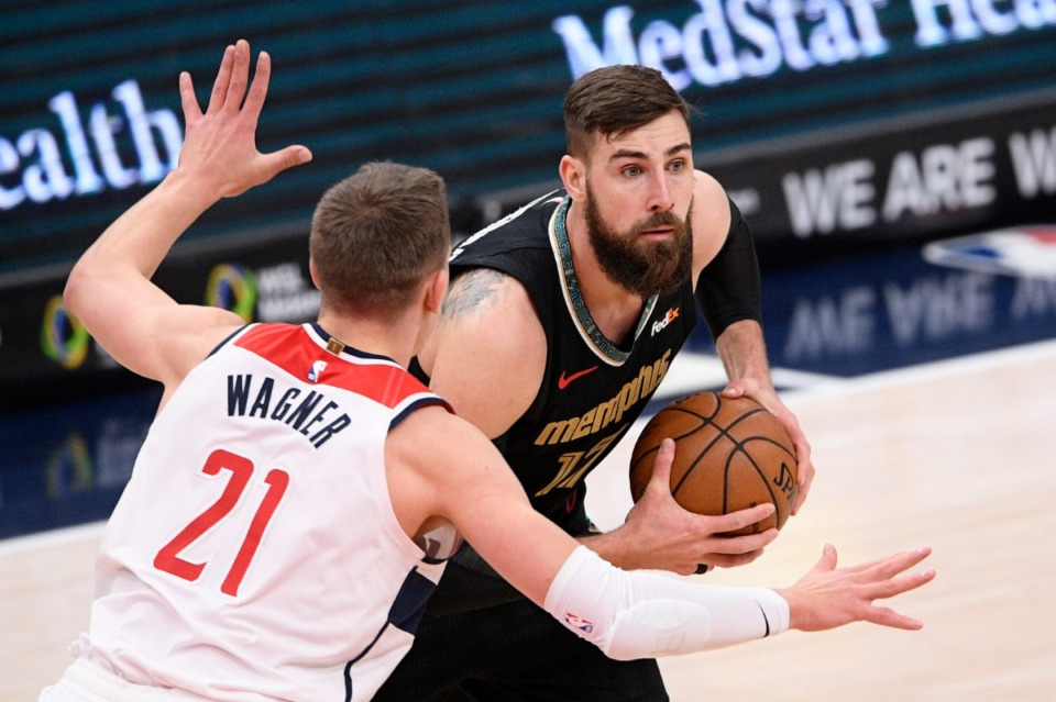 <strong>Grizzlies center Jonas Valanciunas (17) works against Washington Wizards center Moritz Wagner (21) on March 2.</strong> (Nick Wass/AP)