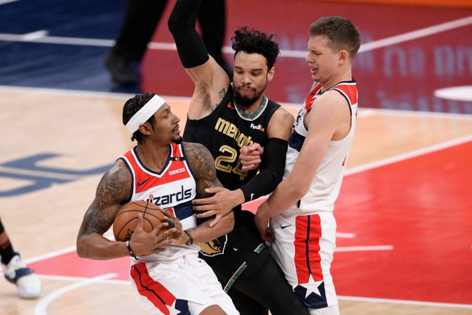 <strong>Grizzlies guard Dillon Brooks, center, guards Washington Wizards guard Bradley Beal, left, on Tuesday. At right is Wizards center Moritz Wagner.</strong> (Nick Wass/AP)