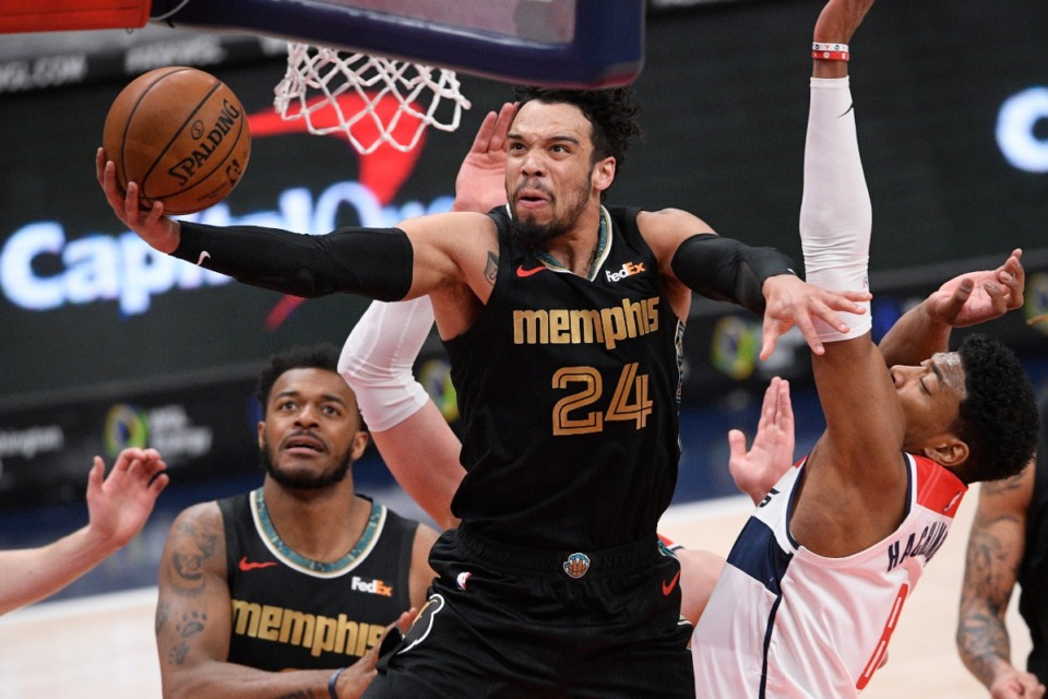 <strong>Grizzlies guard Dillon Brooks (24) goes to the basket past Washington Wizards forward Rui Hachimura (8) on Tuesday in Washington.</strong> (Nick Wass/AP)