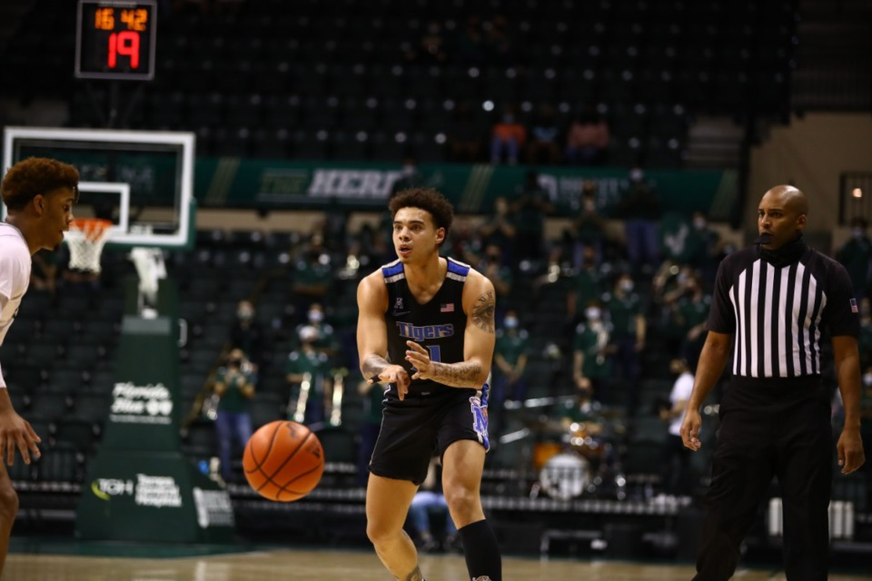 <strong>Memphis Tiger Lester Quinones bounce-passes while assessing the situation in the game against USF on March 2, 2021.</strong> (Courtesy University of Memphis)