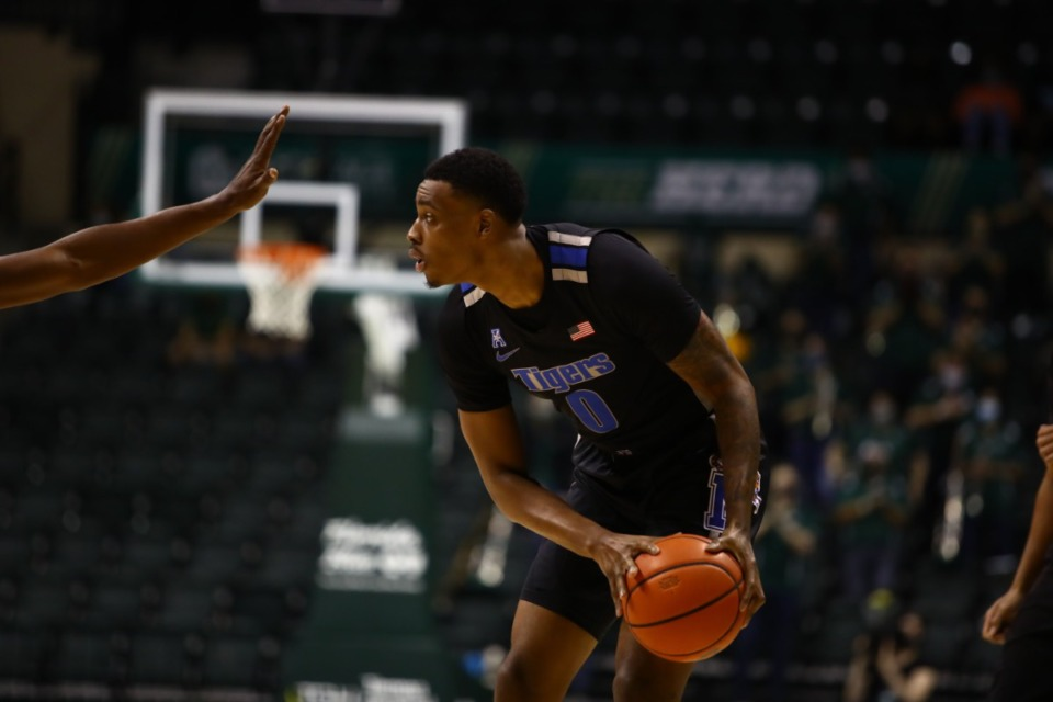 <strong>Memphis Tiger D.J. Jeffries looks for an open man in the game against USF on March 2, 2021.</strong> (Courtesy University of Memphis)