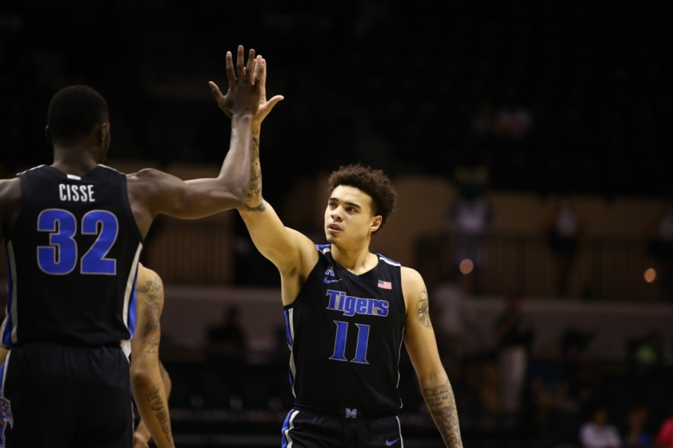 <strong>Memphis Tiger Lester Quinones high-fives Moussa Cisse in the game against USF on March 2, 2021.</strong> (Courtesy University of Memphis)