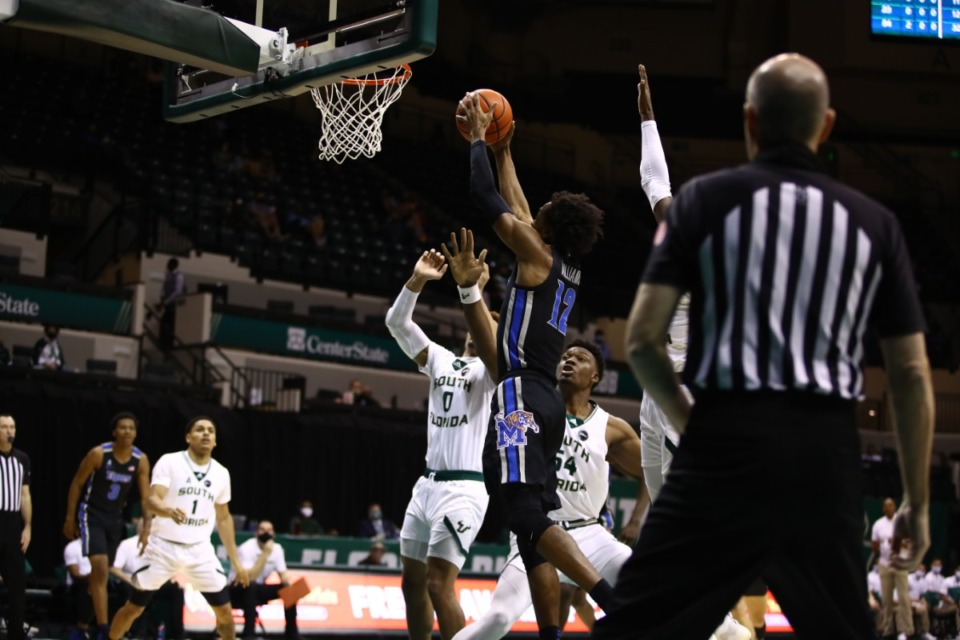 <strong>DeAndre Williams goes up for a layup against USF March 2, 2021.</strong> (Courtesy University of Memphis)