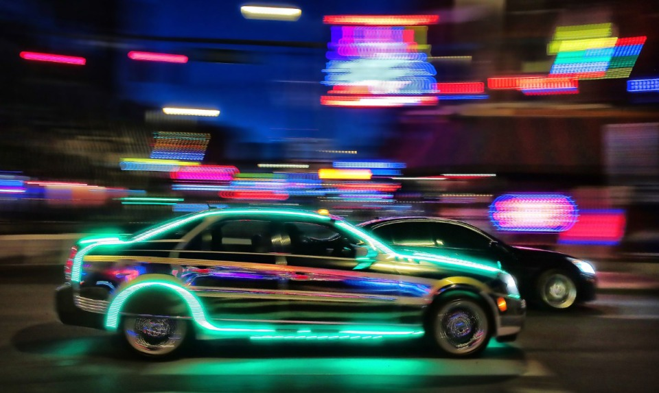 <strong>Muscle cars pass by the lights on Beale Street while cruising B.B. King Boulevard in Downtown Memphis on May 9, 2020.</strong> (Jim Weber/Daily Memphian)